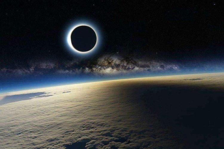 The Earth, eclipsed by the moon. The image expresses how we sometimes must struggle through the darkness, looking for the light.